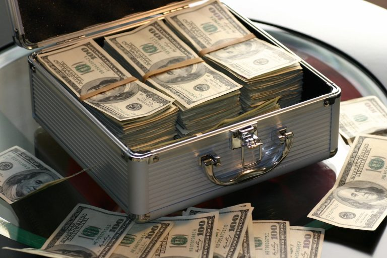 Briefcase full of money representing the cost of pay-per-click advertising.