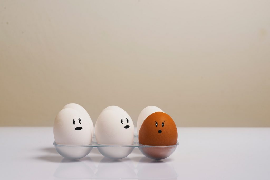 Five white eggs with one brown one, representing differentiation of your products.
