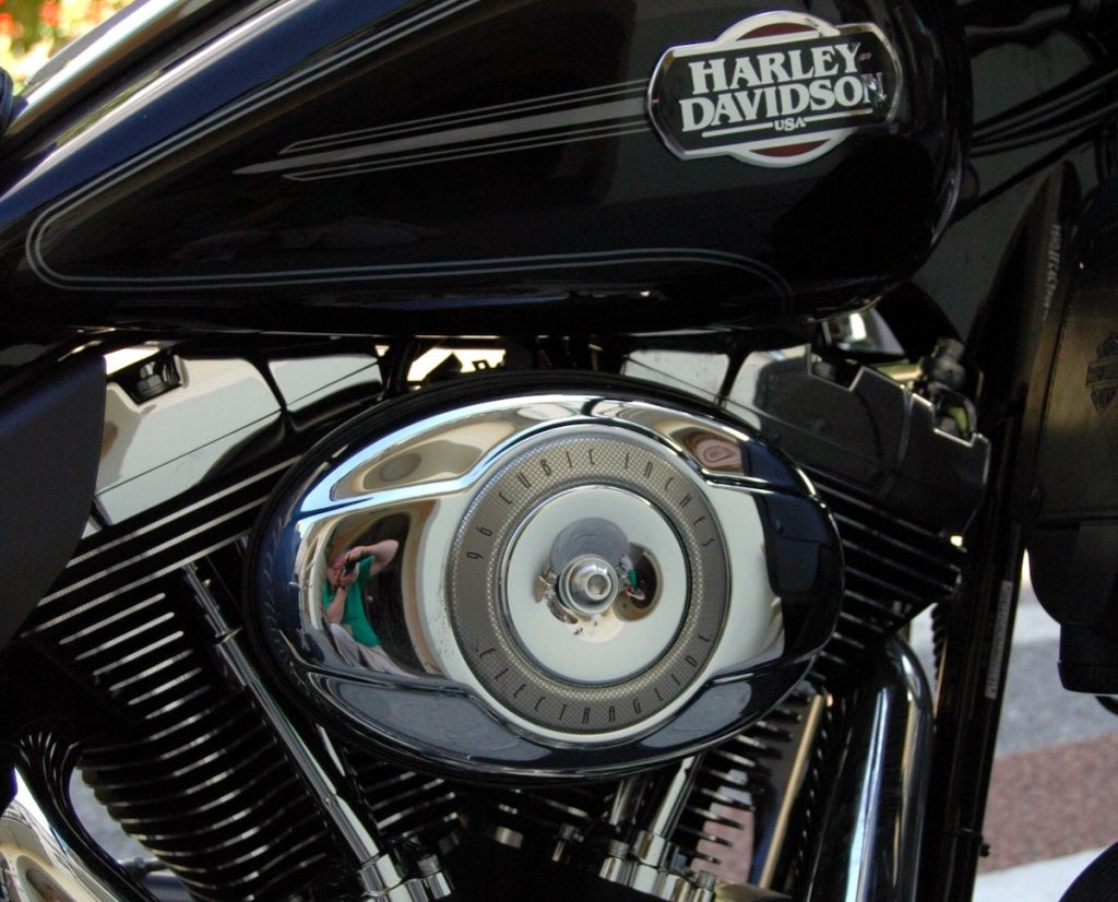 """Harley Davidson emblem on an engine representing the definition of a """"brand""""."""