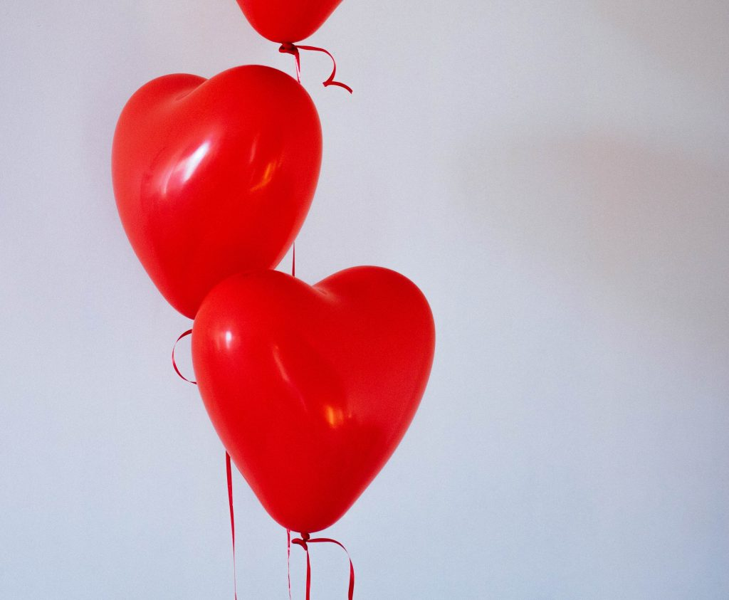 Three red, heart-shaped ballons representing taking care of customers.