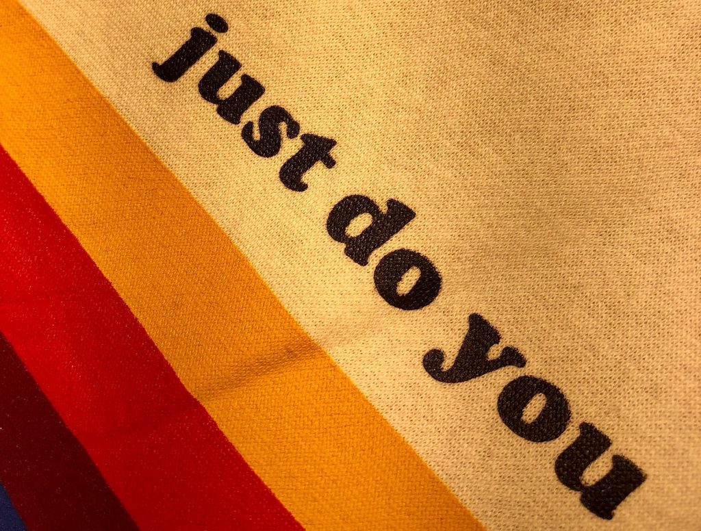 "A textile reading ""Just Do You"" representing being authentic"